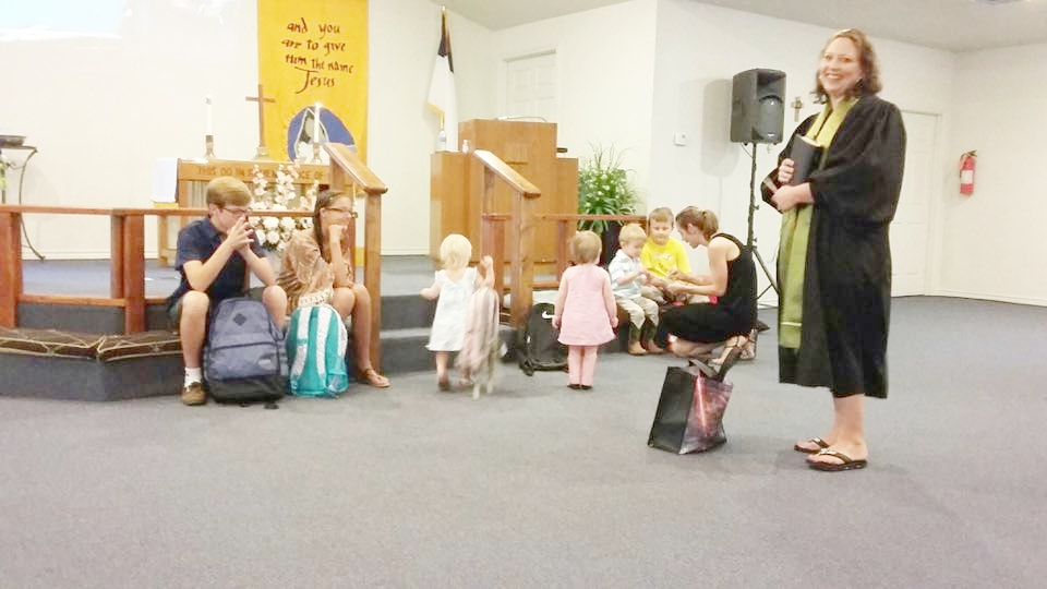 Rev. Donna Shaw leads blessing of the backpacks at Granite Shoals, Grace UMC