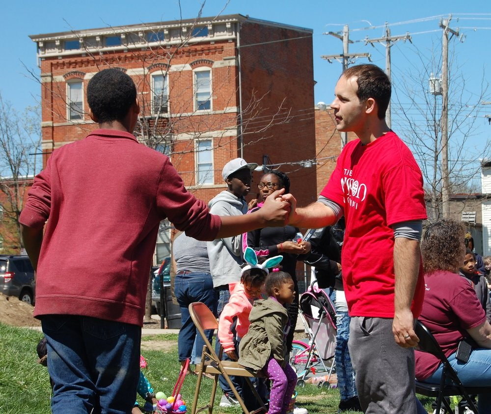 SERVE THE CITY - We love our city and we believe God has called us to pray for our city and to seek it's welfare.  That is why we serve regularly in Evanston and throughout Uptown Cincinnati through seasonal events like a Trunk or Treat, an Easter Egg Hunt, a Christmas Potluck, manning the dunk tank at District 2 National Night Out, tutoring at Evanston Academy, prayer walking in neighborhoods and so much more!  Interested in serving with us in the community?  Stay tuned to our Parish Calendar to learn about upcoming opportunities to serve.  You can also contact Charles Dudley, our Director of Community Outreach at charles@missioncincinnati.org