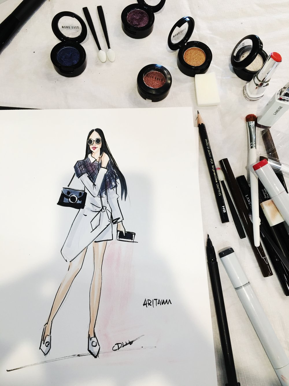 Live fashion sketch influencer  小花  during NYFW for Korean beauty brand Aritaum.