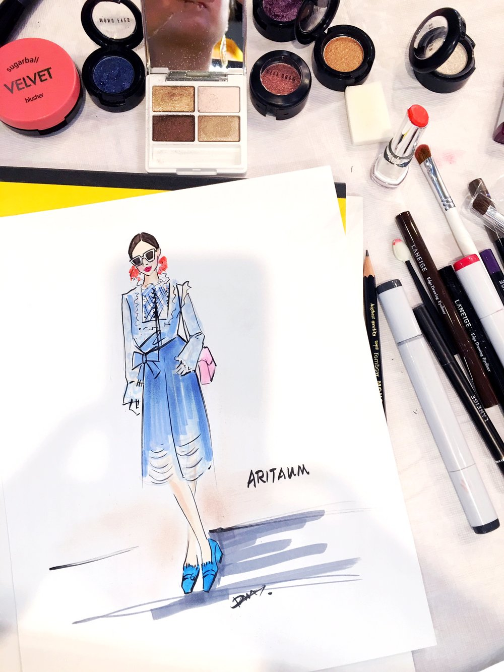 Live fashion sketch influencer  halliedaily  during NYFW for Korean beauty brand Aritaum.