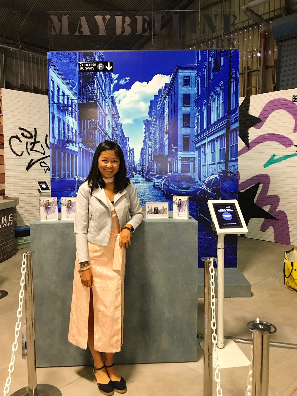 fashion illustrator Rongrong DeVoe at Maybelline New York BeautyCon Booth