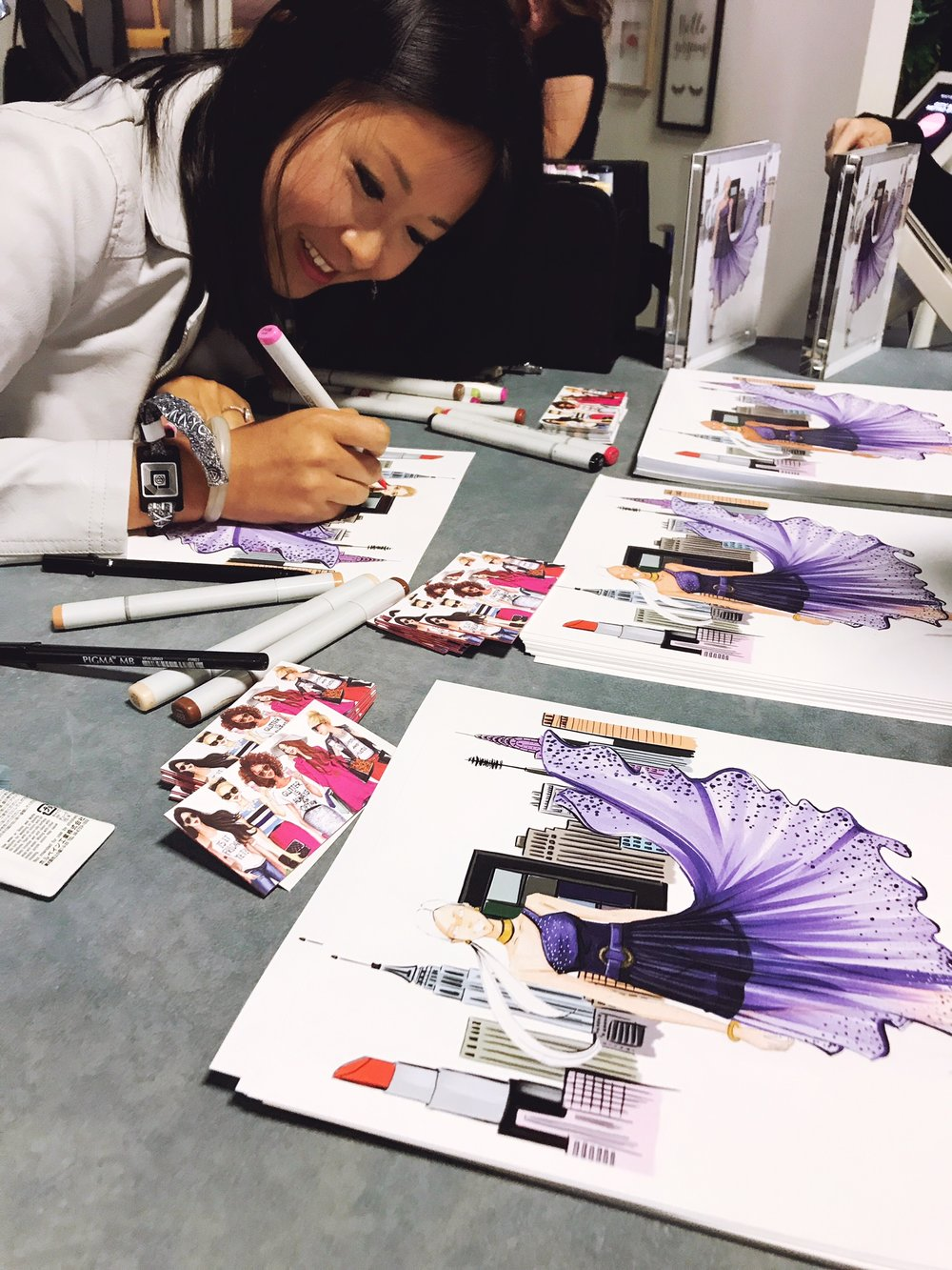 fashion illustrator Rongrong DeVoe at Maybelline New York BeautyCon Booth live sketch customers.jpeg