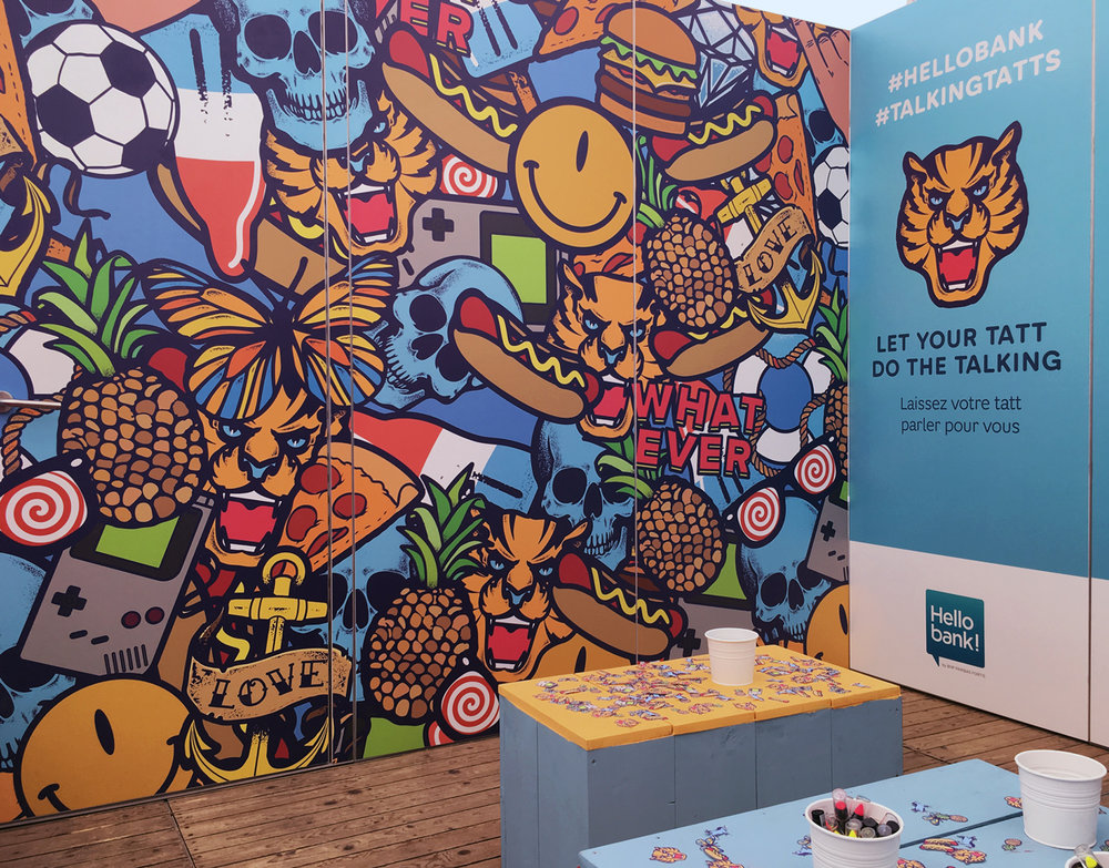 Interior - Illustrations used as a colourful pattern to decorate the inside of the Hello Bank booth.Next to tattoos people could also visit the booth to grab some free textile stickers, draw, recharge their phone or just take a break from the festival.