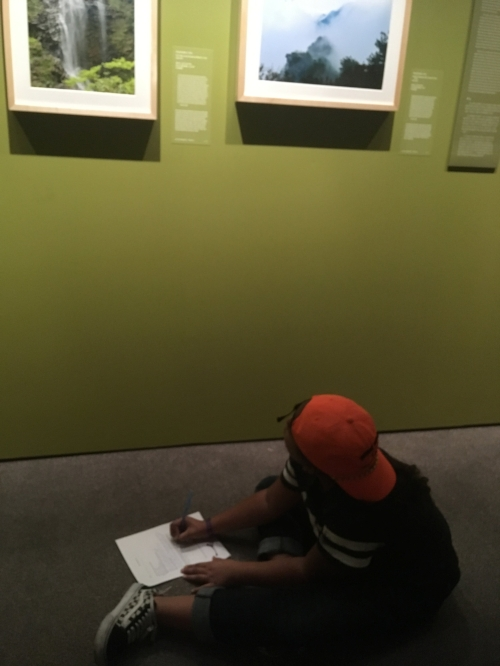 Tristen, a student from Harlem works on a scavenger hunt during an interactive gallery tour.