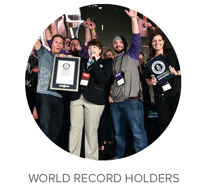 "Guinness World Record Holders  What is Tech Brands? It's this: Spring Mobile, Simply Mac, and the World's Largest Corn Hole Tournament – so declared by none other than the Guinness Book of World Records. ""Officially amazing."" Watch our video  here"