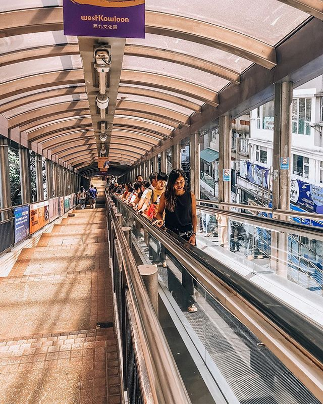"""""""The Central – Mid-Levels Escalator system, is the world's longest outdoor covered escalator system, stretching for over 800-metres and rising 135-metres through the streets of a steep hillside linking these districts of Hong Kong Island. It was opened in October 1993, having cost HK$245 million to build, six times the original estimate. The system is not a single continuous escalator, it is a series of 20 escalators and 3 inclined moving walkways (travelators) , connected in places by footbridges, and with 14 entrances and exits. To ride the complete length of the escalator system one-way takes about 20/25 minutes."""" »»»⠀⠀⠀⠀⠀⠀⠀⠀⠀⠀⠀⠀⠀⠀ #avecnoirxHongKong⠀⠀⠀⠀⠀⠀⠀⠀⠀⠀⠀ »»»⠀⠀⠀⠀⠀⠀⠀⠀⠀⠀⠀ »»⠀⠀⠀⠀⠀⠀⠀⠀⠀⠀⠀ »⠀⠀⠀⠀⠀⠀⠀⠀⠀⠀⠀ #sheisnotlost #girlsthatwander #ladiesgoneglobal #exploremore #ilovetravel #travelbloggers #girlsvsglobe #shetravels #instatravel #instapassport #solotravel #travelgoals #travelwomen #travelwithme #wearetravelgirls #picoftheday #wanderlust #travelandleisure #travelfemme #thetravelwomen #followingthegirls #globelletravels #speechlessplaces #beautifulmatters #traveltagged #beautifuldestinations #travelgoals #beautifulseasia"""