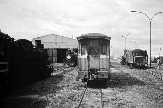 Narrowest passenger car ever? This photo by Anderson shows one of the few passenger railcars maintain by the RFIRT. In the background, locomotive 101 is performing switch movements prior to assembling the train they took from Rio Gallegos to the mine at Rio Turbio.
