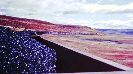 This shot taken from the first car behind the locomotive shows the 50+ car train snaking through the beautiful, albeit barren, valley landscape that the FIRT called home.