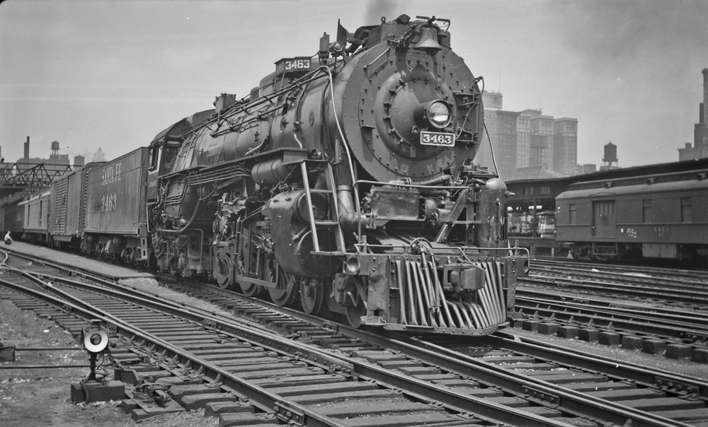 On July 6, 1948, locomotive 3463 stands ready to haul its next train out of Dearborn station in Chicago. Already the locomotive has been modified by the ATSF: the boiler check valves have been moved to the top of the boiler and the whistle has been moved to the front of the locomotive. Image from the collection of Warren M. Scholl, photographer unknown.