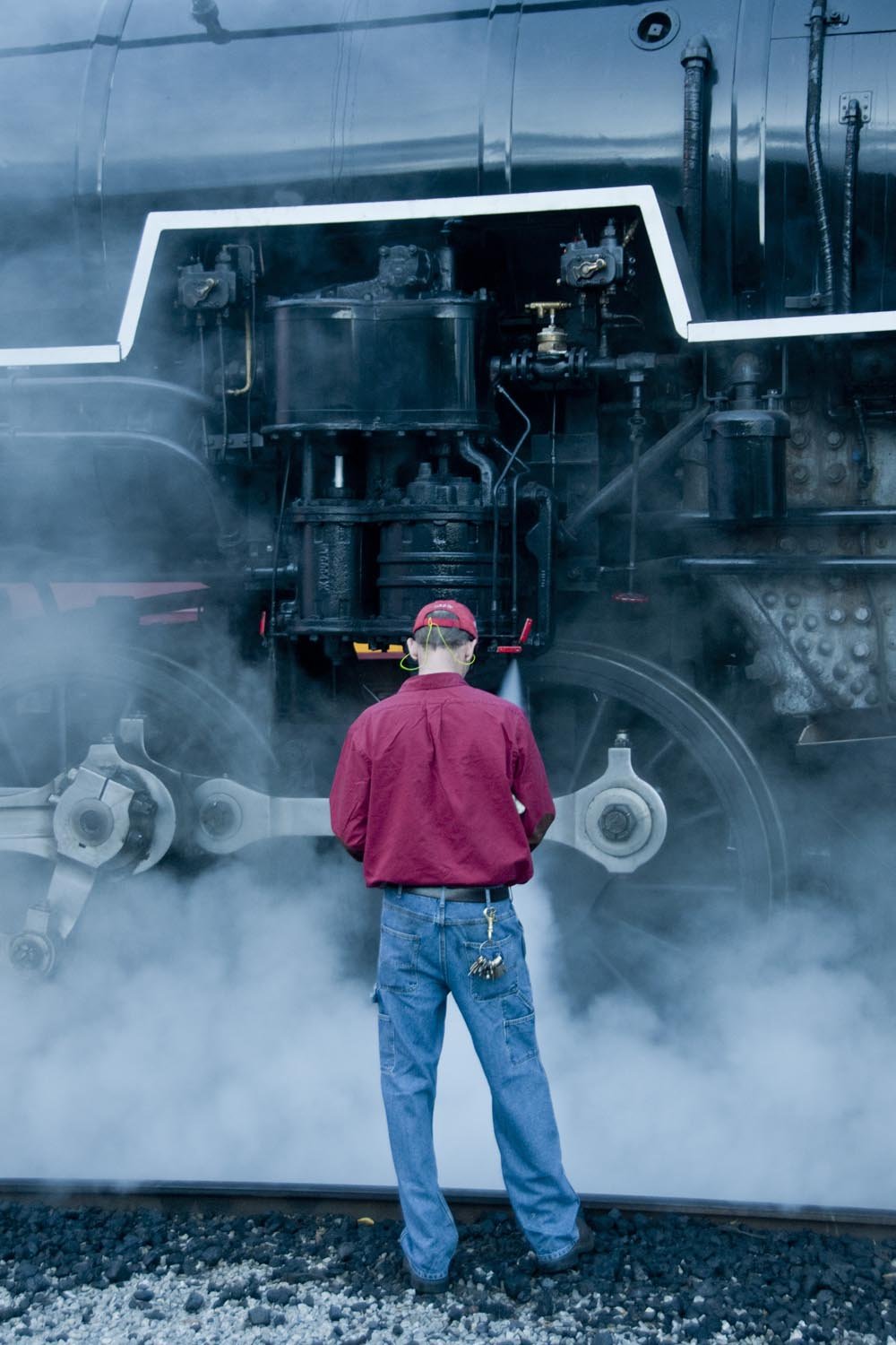 Shane Meador stands beside 4501 as he starts up its cross compound air pump.