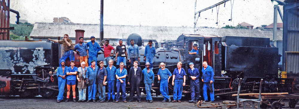 Girdlestone (middle with arms crossed) and the shop crews at ACR stand before locomotive 138 in February 1996. Photo: collection of S.T. McMahon