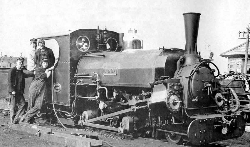 "Girdlestone (forefront in the cab) with ""Linda"" post conversion on the Ffestiniog Railway. Note the new smokestack with reinforced gussets along narrow portion. Photo: G. Rushton, collection of S.T. McMahon"