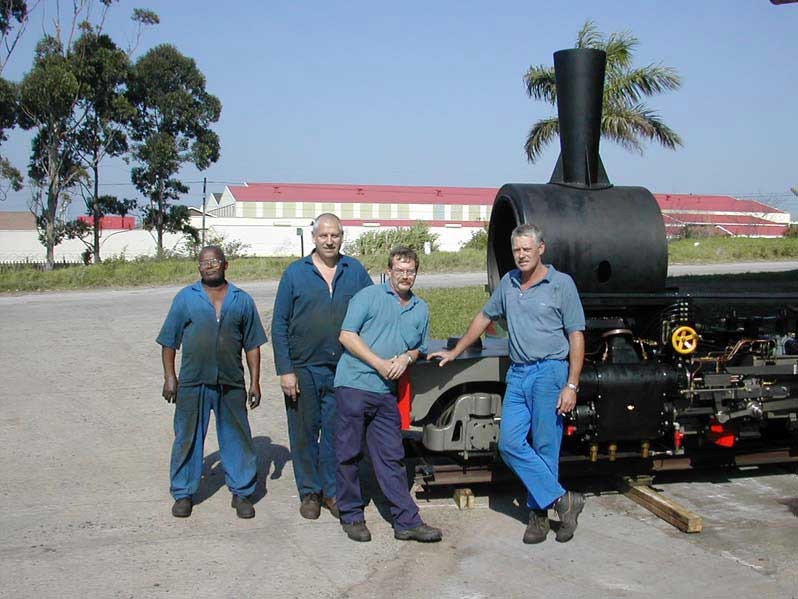 From 2003, Girdlestone (second from right) stands with some of his crew members beside the two foot gauge Class LSN he was building from scratch for a customer in the UK. Photo: collection of S.T. McMahon