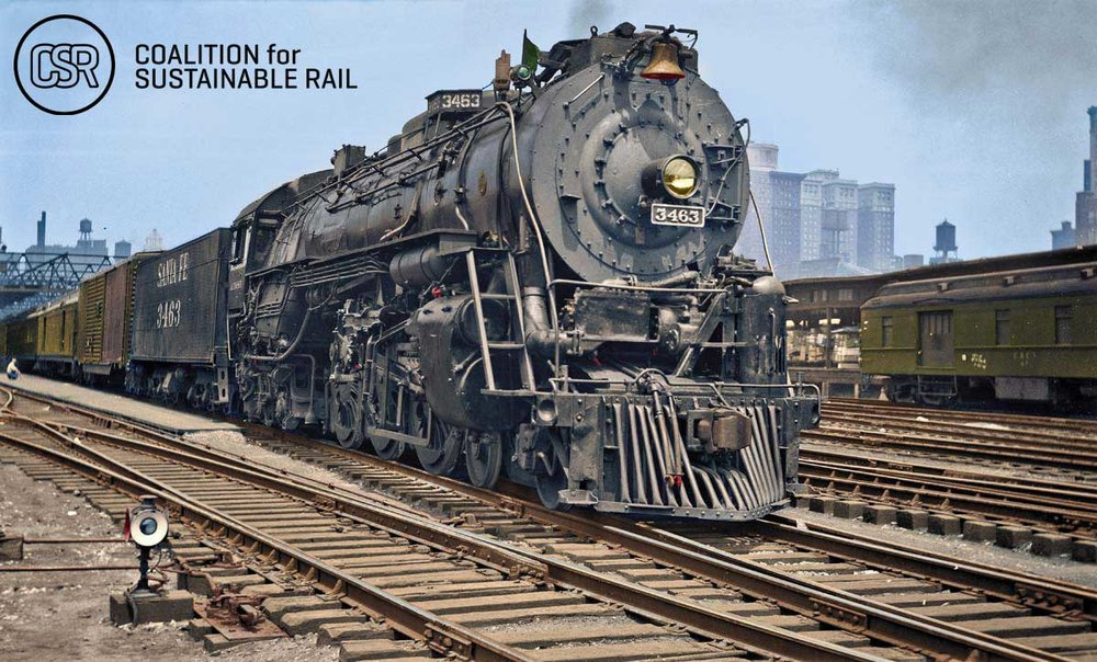 On July 6, 1948, Santa Fe steam locomotive No. 3463 rests between runs at Dearborn Station. Photographer unknown, from the collection of Warren Scholl, colorized by Jared Enos in 2015.