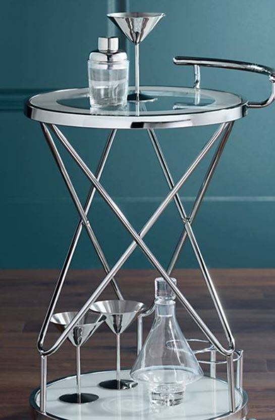 A bar cart of course. It would just look pretty in the corner with these martini glasses. Purely decoration for the soul.