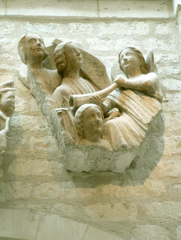 Relief of angel holding horn with facets, Cathedral of Notre Dame, Paris. Last judgement portal relief (original?). Musée de Cluny, Paris.