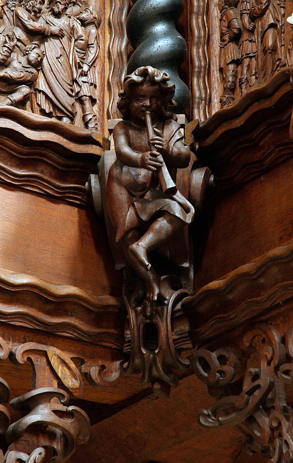 A cornetto-playing putto on the pulpit in Sorø, Sjælland, Denmark.