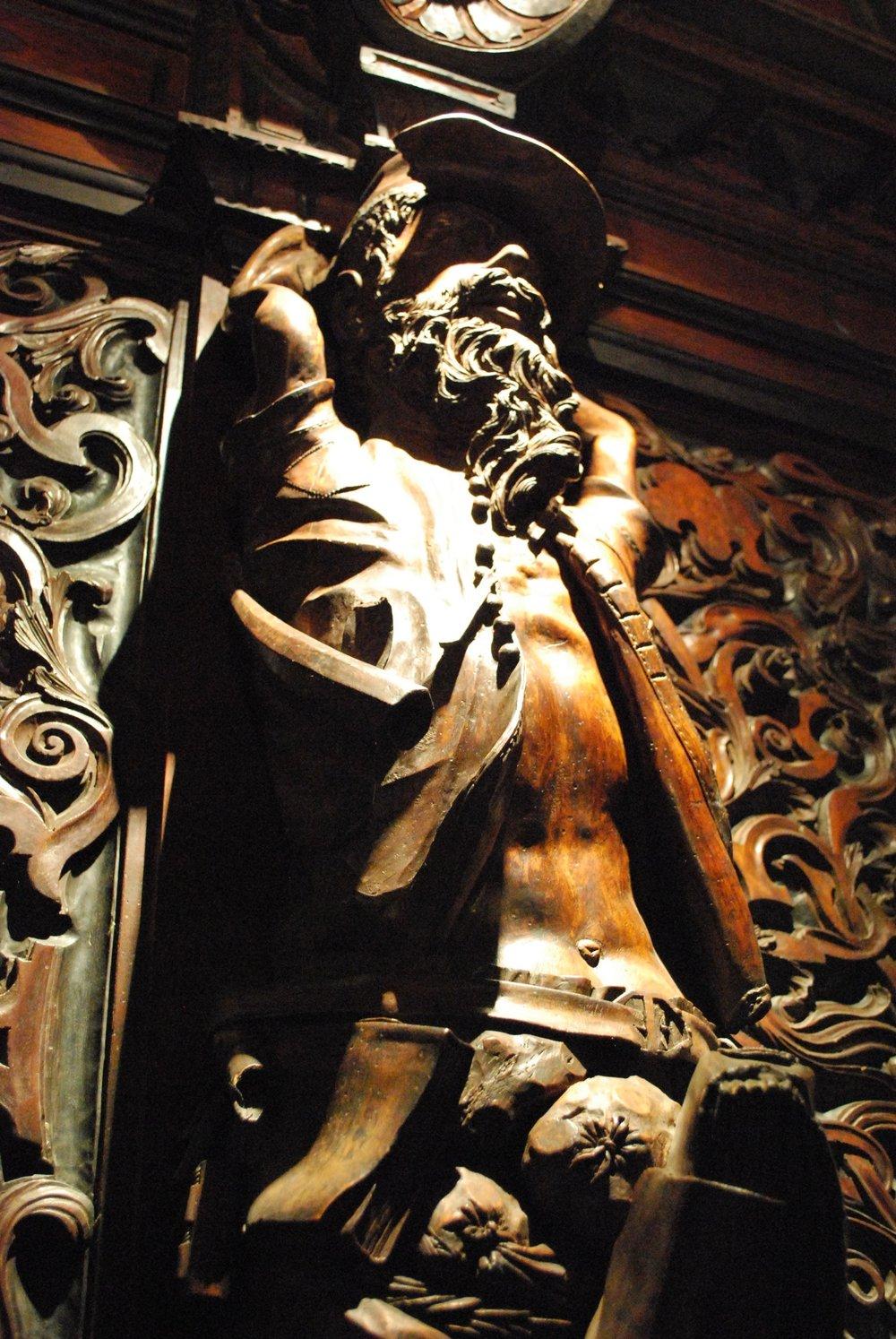 Statue personifying avarice in the Scuola Grande di San Rocco, Venice.