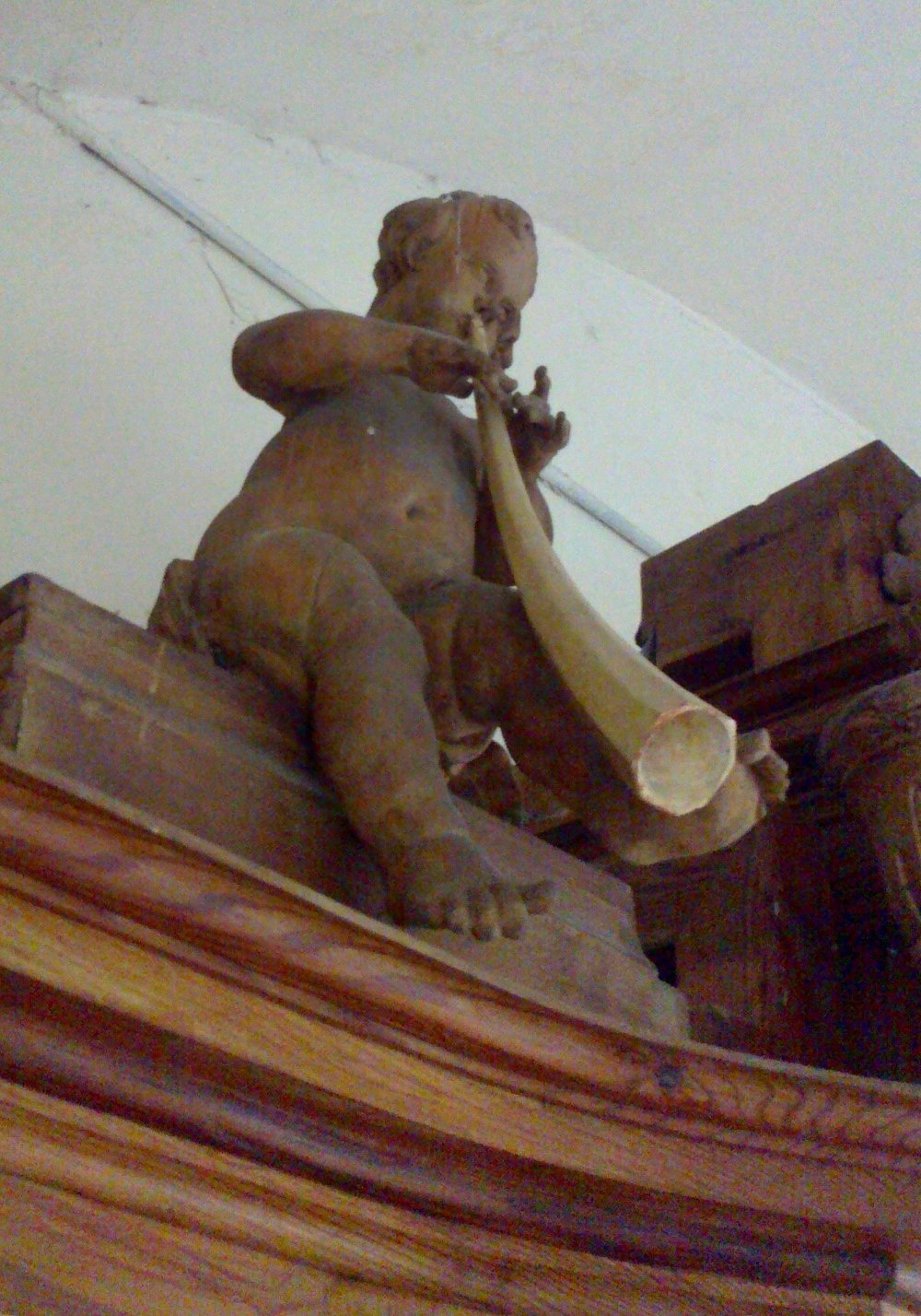 Cornetto playing putto on an organ case from 1774.