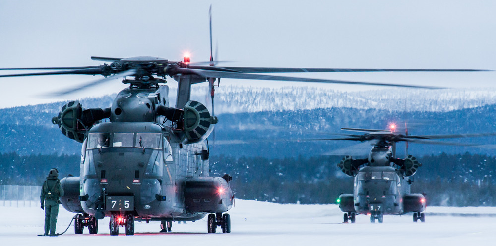 "Two Sikorsky CH-53GA ""German Advanced"" equipped with EAPS and a  SELEX GALILEO FLIR111 , gearing up for a training flight at Ivalo Airport"