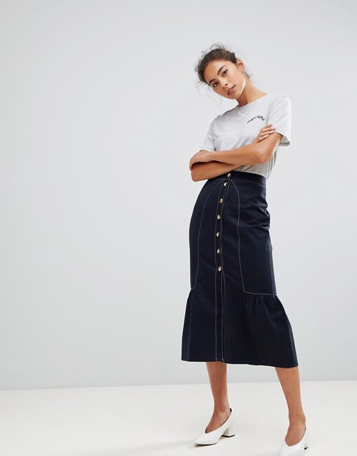 Denim skirts are back, but with an upscale twist. I'm loving the white seaming in this look— it would look great for a casual chic look with a white button down. - $28