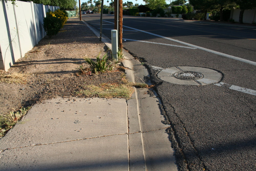 Many street sections have abruptly ending sidewalks, heaving concrete, and sections so narrow that it's necessary to step off the sidewalk to avoid obstacles.