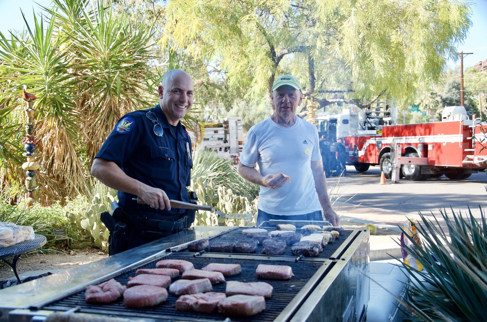 Officer Ben Carro along with Tim Moman showing off their grill skill.   Yes, those are huge burgers and they were BBQ-ed to perfection.