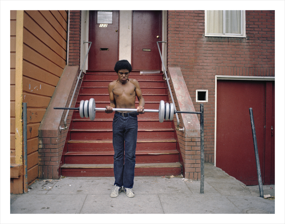 Boy lifting weights, 122 Langton Street, 1979 Archival Pigment Print, 2016 16 x 20 inches, edition of 5 20 x 24 inches, edition of 2 30 x 40 inches, edition of 2