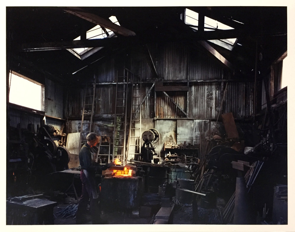 Johnny Ryan, Blacksmith, Klockars Blacksmith and Metal Works, 443 Folsom Street, 1980 Vintage Chromogenic Print 11 x 14 inches and 14 x 17 inches