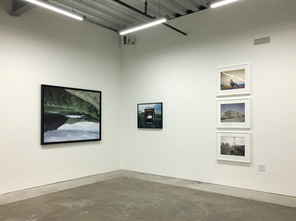 CHRISTINA SEELY,  Defluo Glacies and Matanuska Glacier, Alaska,  2011; JANET DELANEY,  Artist in her studio, Project One, 10th at Howard Street, 1979  and  First Office Building in redevelopment zone, from Lapu-Lapu Street, 1980  and  Saturday afternoon, Howard St between 3rd and 4th Streets, 1981