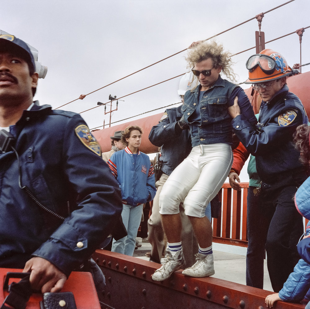 JANET DELANEY  Arrest, Golden Gate Bridge 50th Anniversary Party,  1987 from  Public Matters  Archival Pigment Print, 2018 9 x 9 in. [22.8 x 22.8 cm] Edition of 7 + 2AP