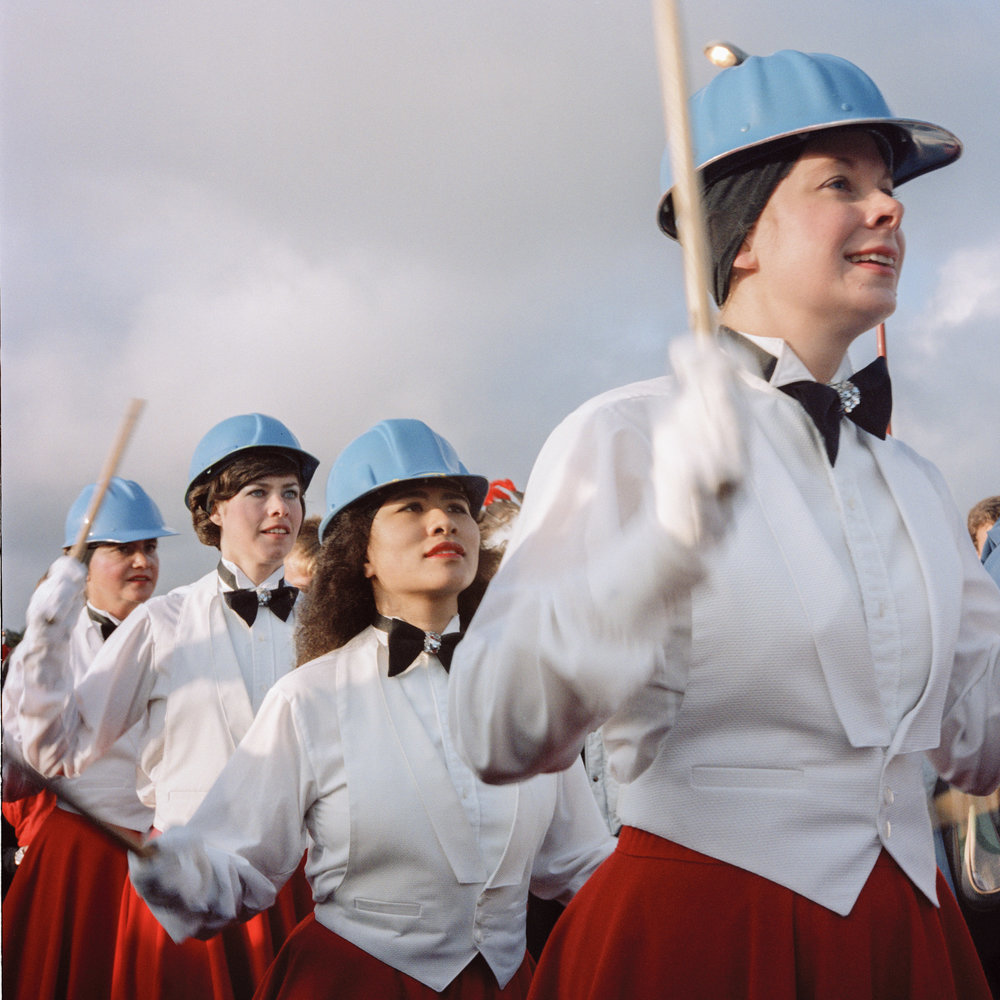JANET DELANEY  Drummers, Golden Gate Bridge 50th Anniversary, 1987  from  Public Matters  Archival Pigment Print, 2018  Available in 3 sizes 9 x 9 inches, edition of 7 + 2AP 15 x 15 inches, edition of 3 + 2AP 22 x 22 inches, edition of 2 + 1AP