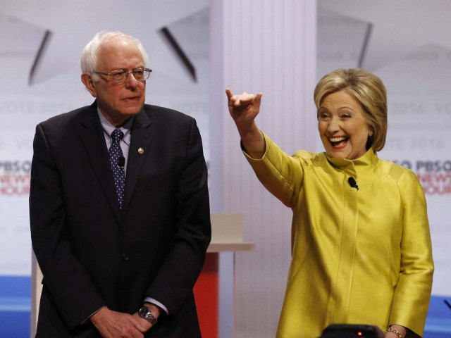 Sanders and Clinton at PBS Debate;  Photo: Morry Gash/AP