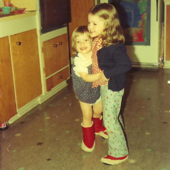 Kelly and Erin circa 1976. If your kitchen still looks like this, we can help!