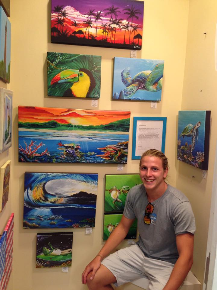 This is a picture of me sitting next to my work in Island Art Gallery.  The owner Bruce gave me my first opportunity to showcase my work in his store. Its Located in the Merritt Island Mall go check it out!