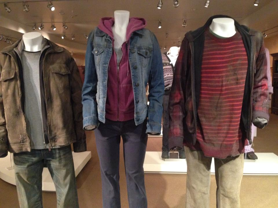 Costumes worn by Daniel Radcliffe (left), Emma Watson (center), and Rupert Grint (right) from  Harry Potter and the Deathly Hallows: Part 2.