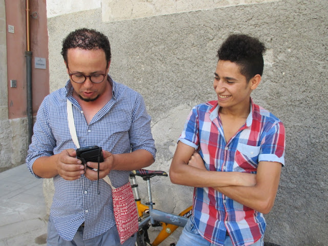 Ramzi with his indispensable cell phone and Ahmed, Siracusa, July 2016