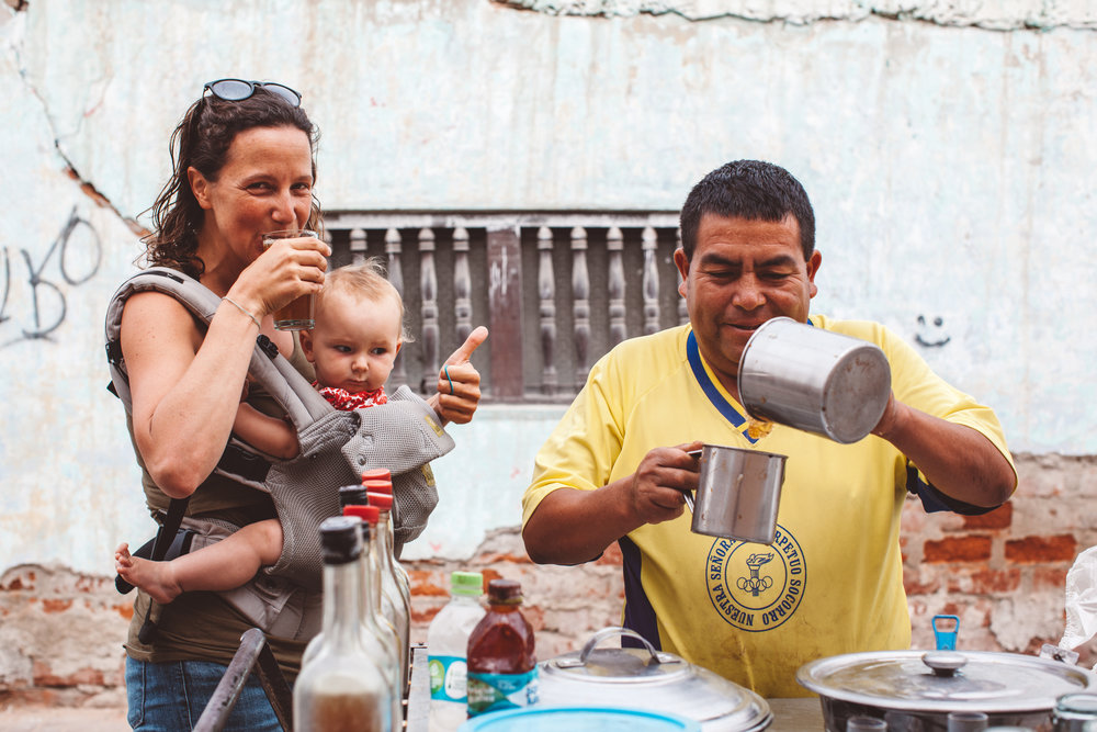 Amy drinking local chicama with her baby  —  Source: Catherine Bernier (   @cath.be   )