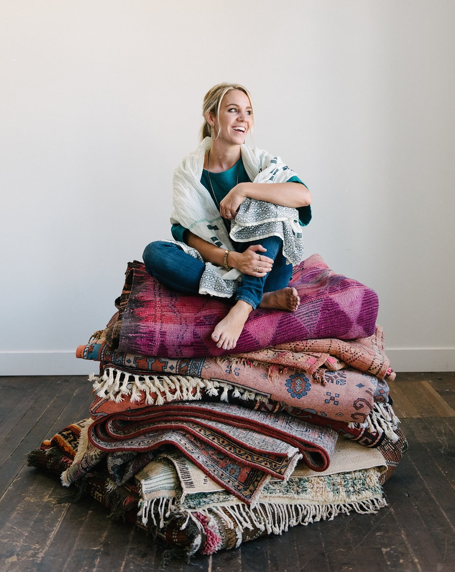 ABOUT  -  Hello beautiful people! I'm Hannah Loumeau Leonard, the founder of Loom + Kiln. With a background in art and interior design, and a passion for traveling, it quickly became my dream to open up a shop that explored all the different styles and designs that the world had to offer.  Staying true to it's name, Loom + Kiln focuses mainly on textiles and ceramics. On one page you might find a 60 year old rug from a small village in Morocco, and on another a handmade vessel made a week ago from your local ceramicist. Either way, you'll be able to see the love and care that goes into an item that's touched by a human hand. It's through these pieces that homes become a place of beauty and wonder, and that tell a story of the people inside.