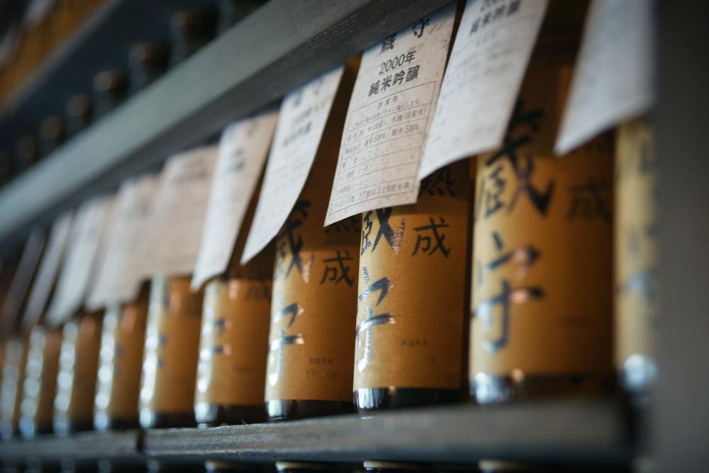 Sake bottles being aged