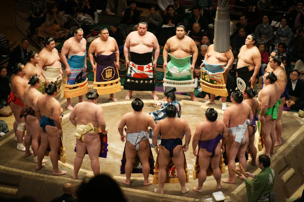wearing their kesho-mawashi, ceremonial aprons