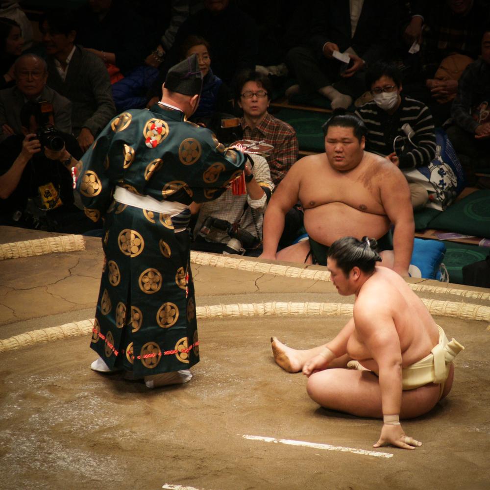 Referee, Gyoji, declaring a winner