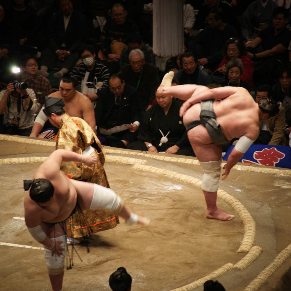 Both wrestlers stomping their legs before the match