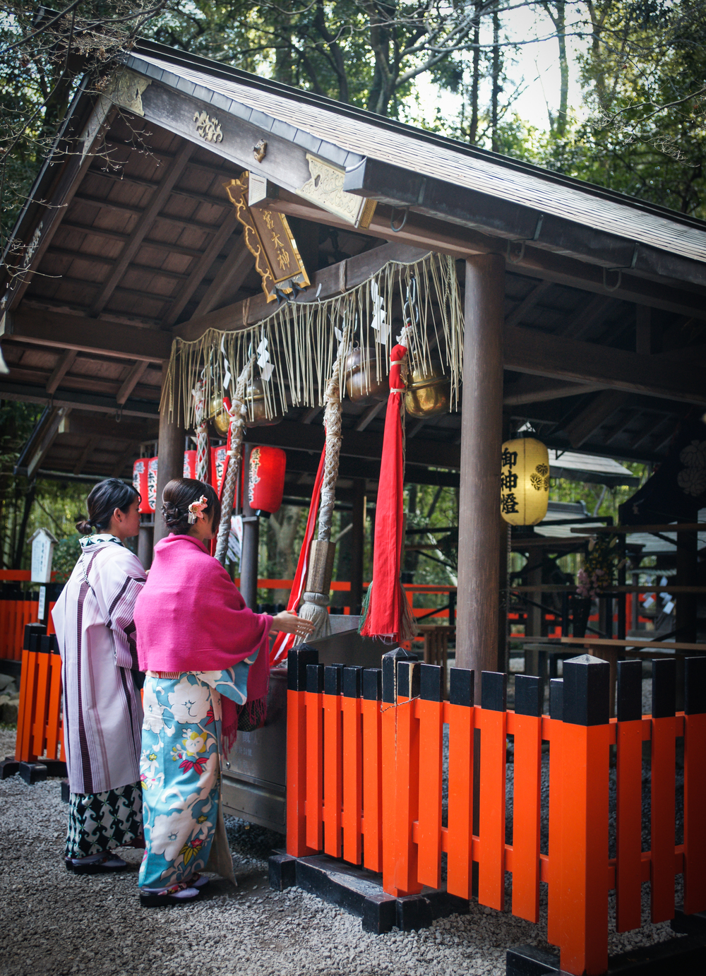 Girls ringing the Bell at Nonomiya Shrine