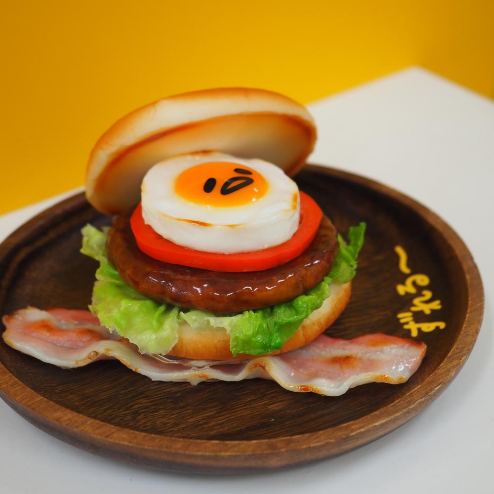 Gudetama atop a burger