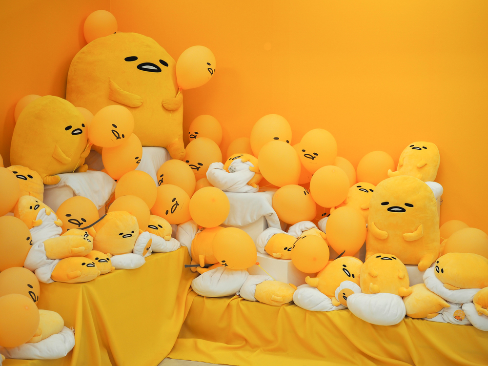 a heavenly pile of Gudetama pillows as you exit