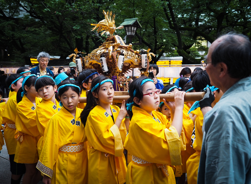 young kids carrying a mikoshi