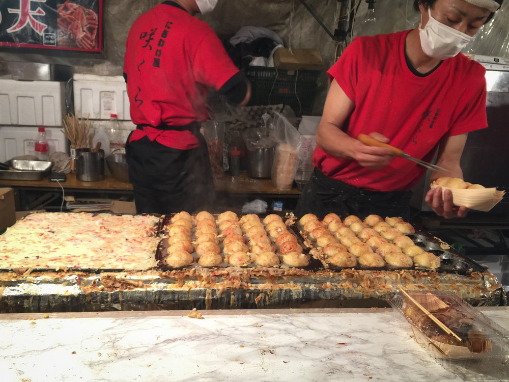 Street food vendor making Takoyaki-octopus balls