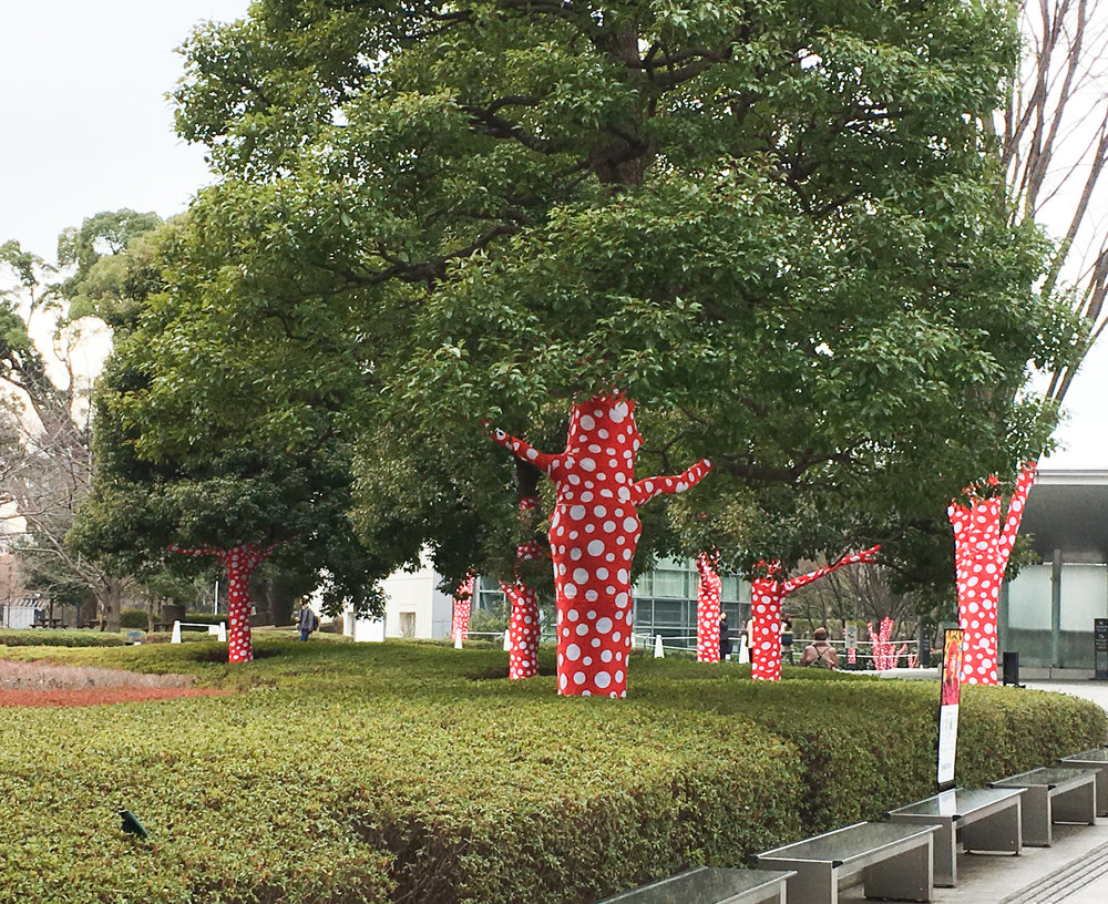The tree outside of the Gallery wrapped in red and white polka-dots