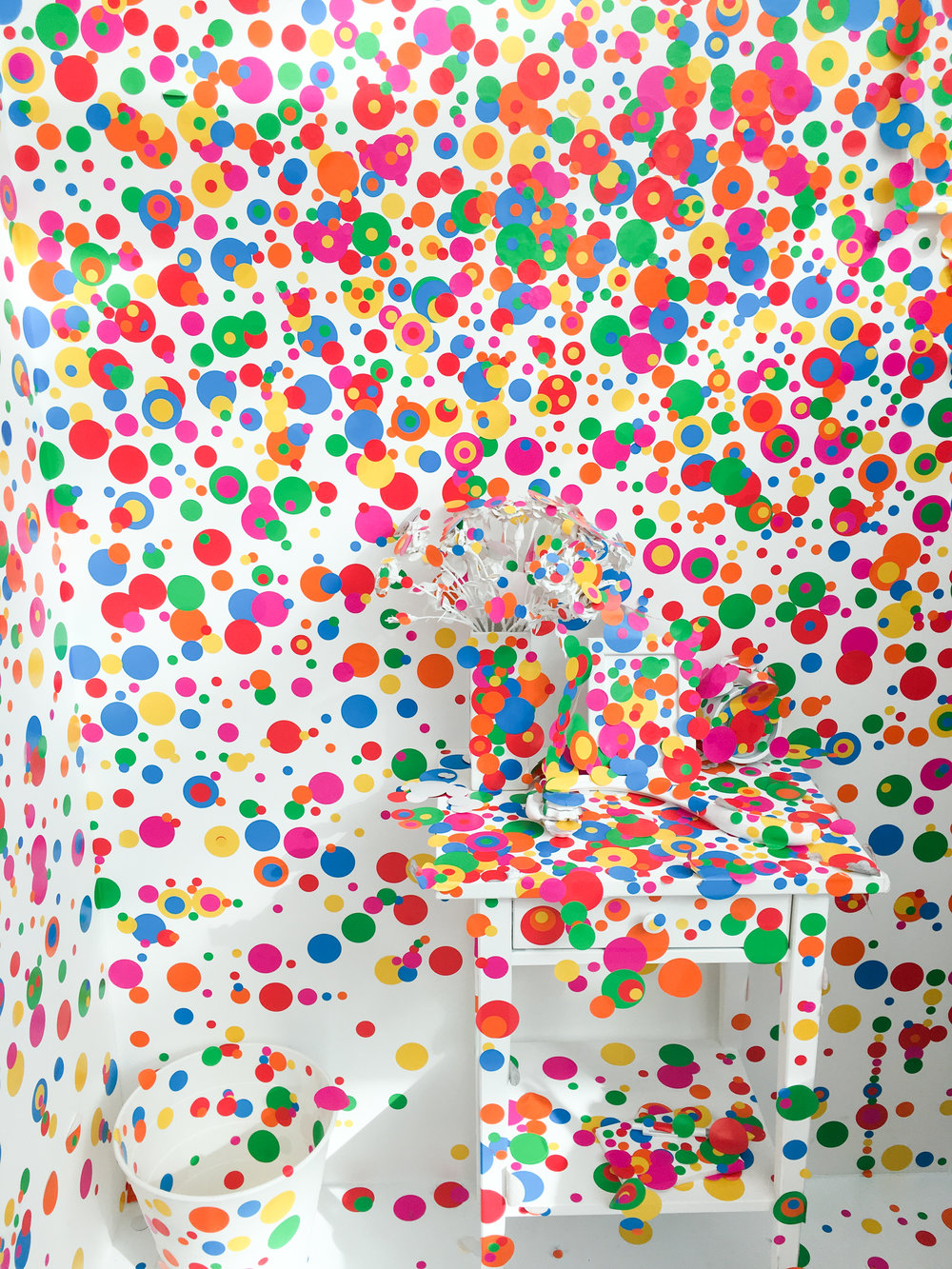 visitors could add dot stickers to a once white room